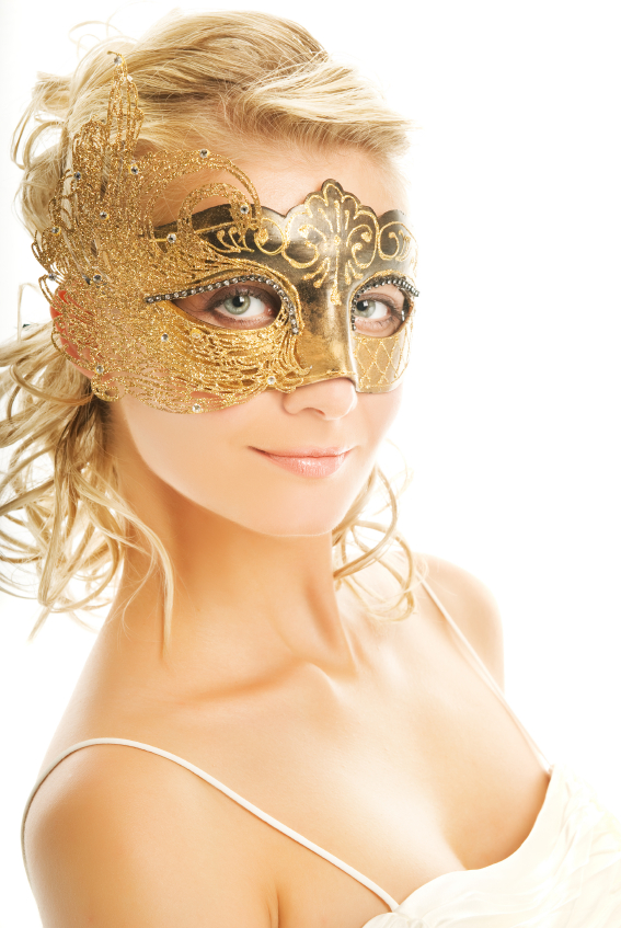 Beautiful blond woman in a golden carnival mask
